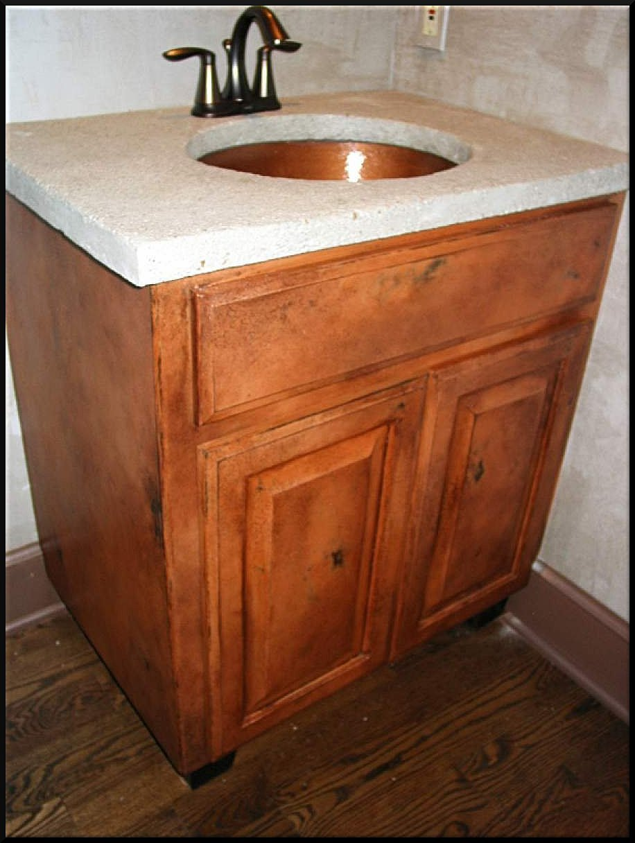 Farmhouse shabby chic vanity with a distressed concrete top.