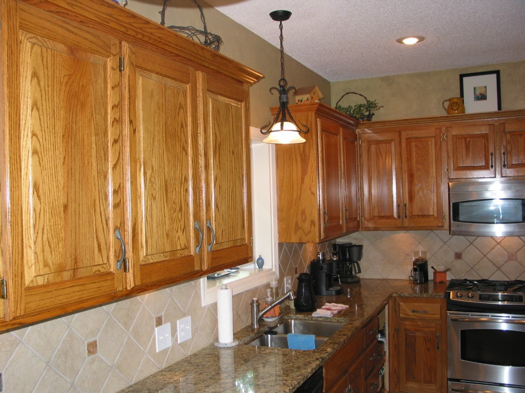 refinishing golden oak kitchen cabinets cabinet refinishing before and after 7707
