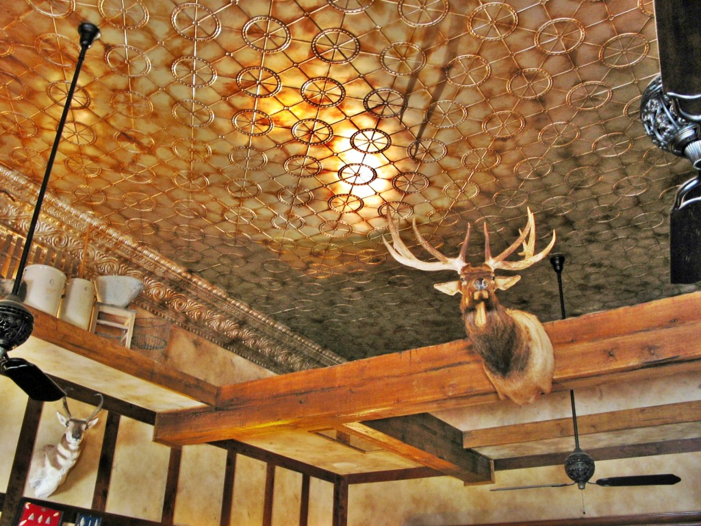 Finished ceiling and beams with mounted animal heads.
