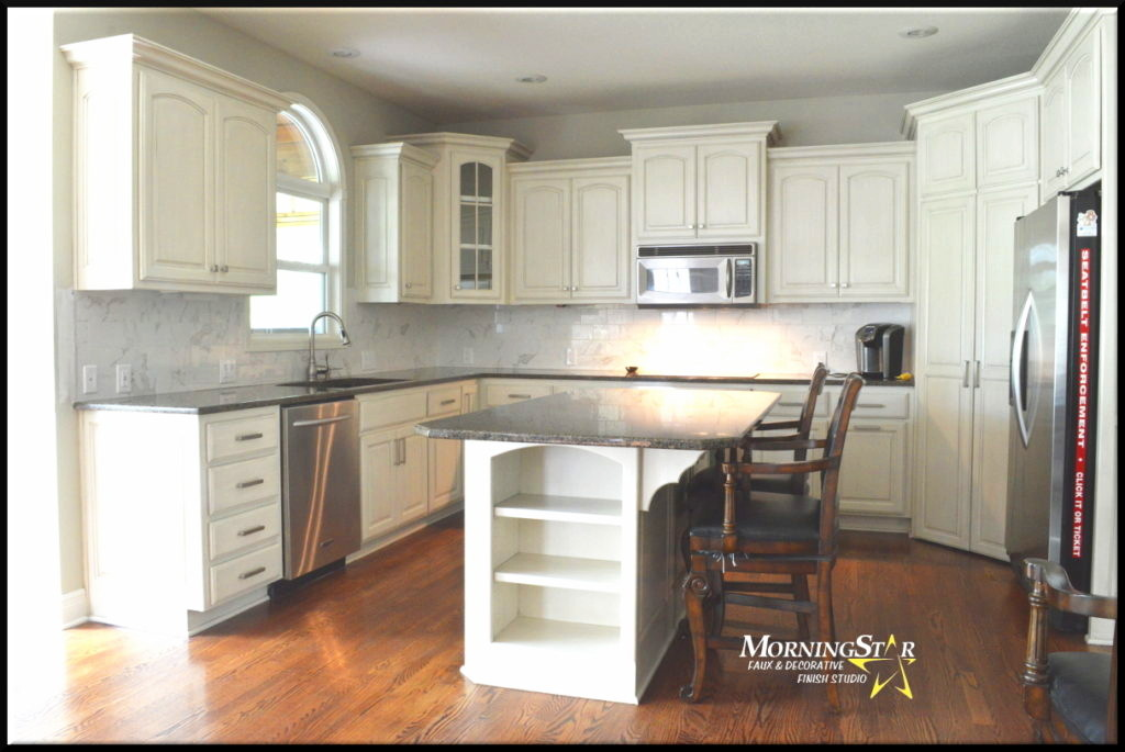 White kitchen cabinet refinish with a light glaze done over stained birch.